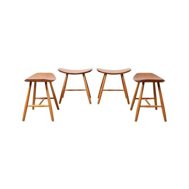 Set of four birch stools designed by Ejvind Johansson and produced by FDB Mobler, Denmark. These are considered Model J63....