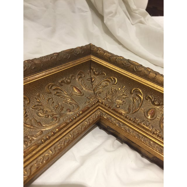 "Heavy gilt frame with deep carving detail. Overall measurements are 19.25"" x 16.25"" x 2.5"" and holds artwork 9"" x 12"" with..."