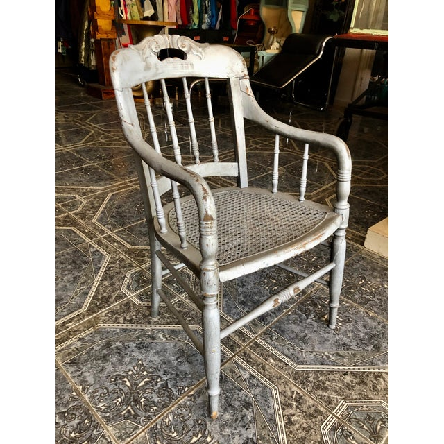 One of several hundred pieces to survive a 5-alarm warehouse fire... this charming and hardy lilac vintage wood chair with...