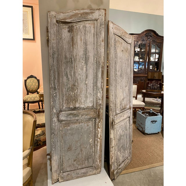 """Antique pair of chippy paint doors with hardware. Use as intended or hang on a wall. 22"""" Wide x 1"""" Deep x 71"""" High"""