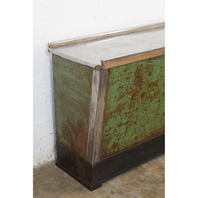 This American country store counter is from New England. From the distressed patina we assume that it was used as an...