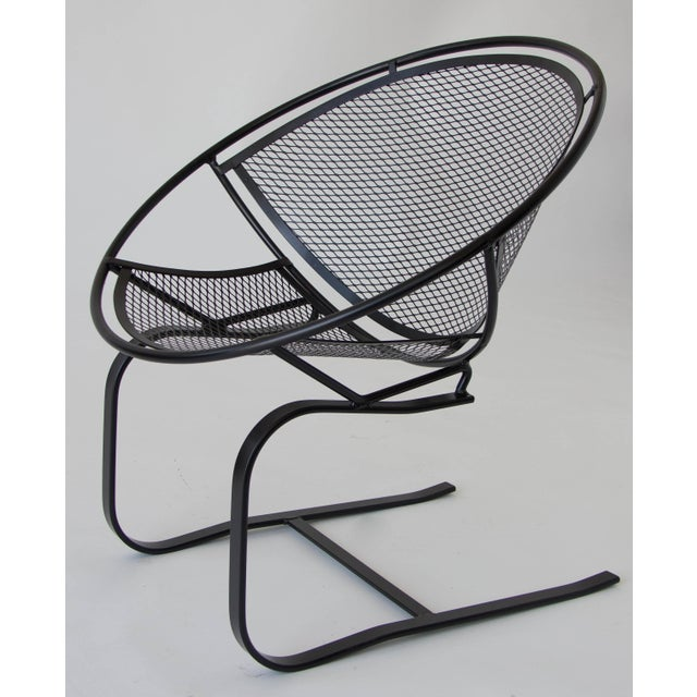 "Two wrought iron patio rocking chairs from the ""Radar"" line, designed by Maurizio Tempestini for John Salterini. Each..."