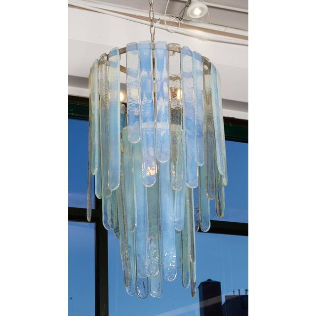 A rare and early design this elegant chandelier has subtle but magnificent iridescent glass.