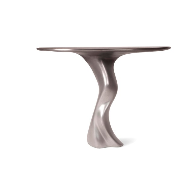 Haya console table is a stylish futuristic sculptural art table with a organic form designed and manufactured by Amorph....