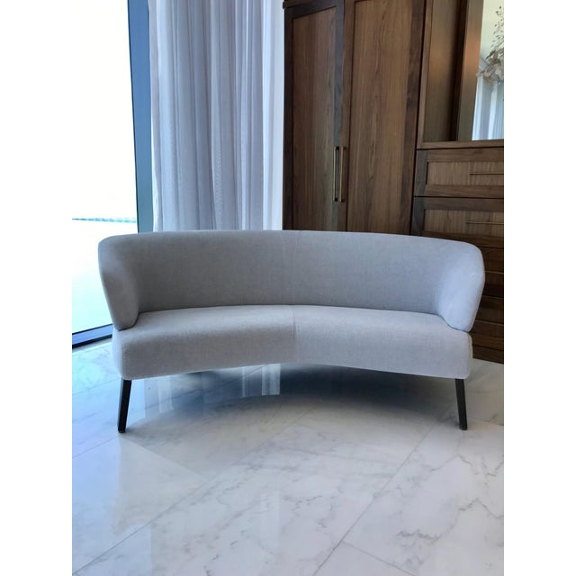 Exceptional semi-round lounge sofa from the Creed Series, designed by Rodolfo Dordoni for Minotti. Versatile curved form...