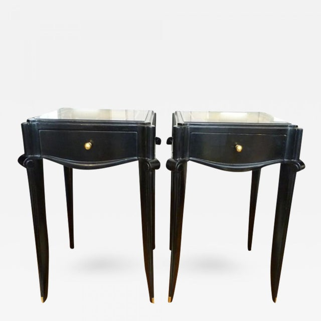 JEAN PASCAUD Black varnish and gold sabot side table.