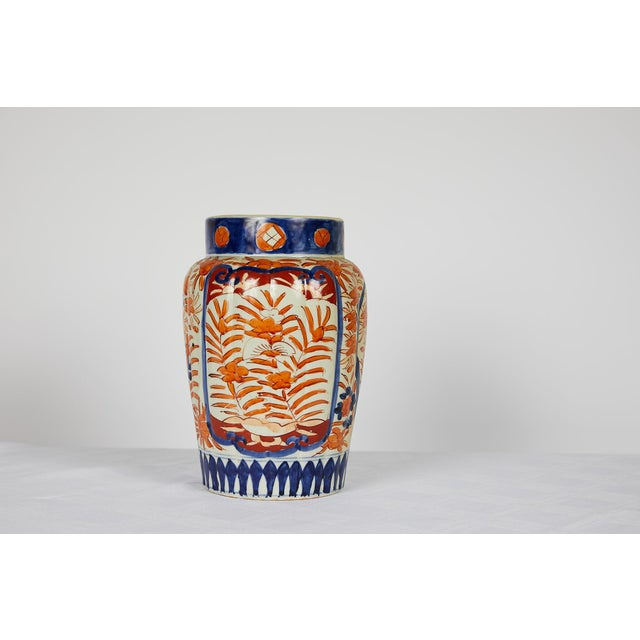 This is a Japanese Imari vase which dates to the early part of the 20th century. This vase has a distinctive shape with...