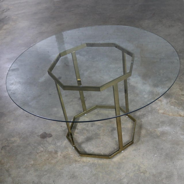 Handsome brass plated metal tube octagon dining table base with round 3/8 inch glass top in the style of Milo Baughman for...