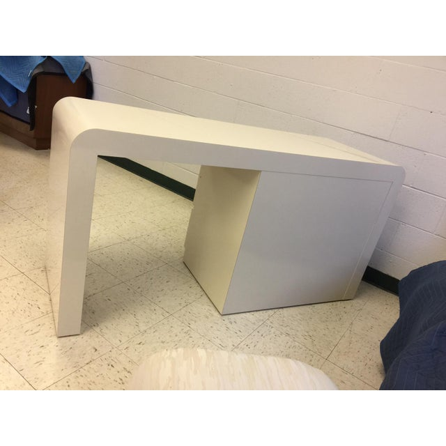Vintage white lacquer waterfall desk / vanity in the style of Karl Springer. Comes with original stool - upholstery in...