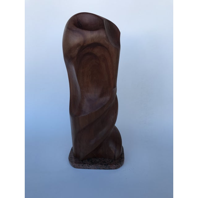 This mid-century styled carved abstract wooden sculpture has good movement to it, with its curved and spiraled lines. It...