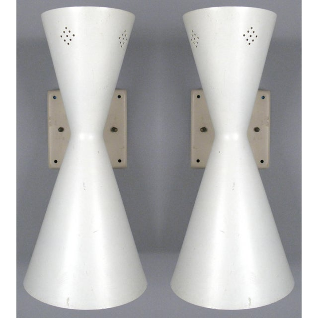 a pair of classic 1950's mid century wall sconces with double cone design. each sconce has a larger down facing cone, and...