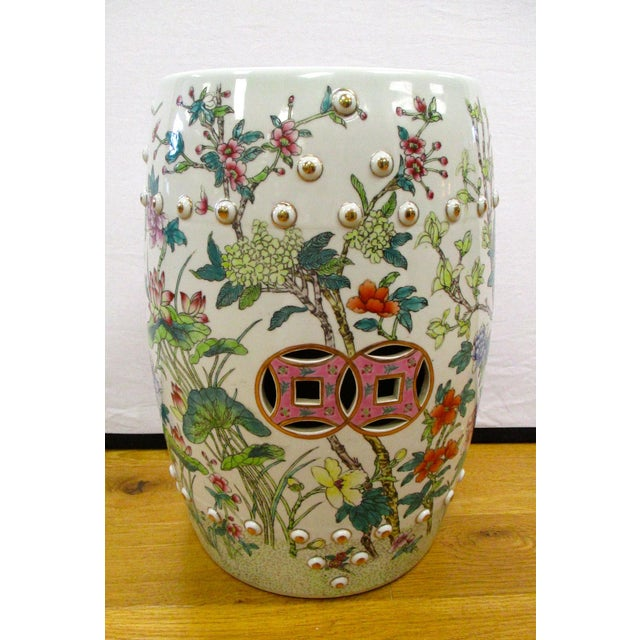 Chinese porcelain garden stool with hand painted flowers and birds all around.