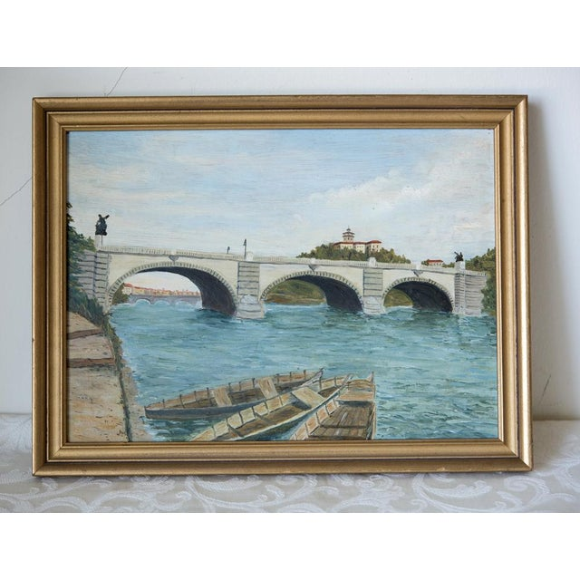 """Cheerful vintage French oil on wood of the Pont Neuf bridge in Paris. The gilt wood frame measures 15-1/4"""" by 11-1/2"""" wide..."""