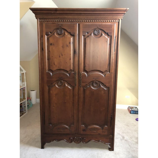 This vintage beauty is both eye-catching and practical. Double doors open to ample storage with 5 shelves for organizing....