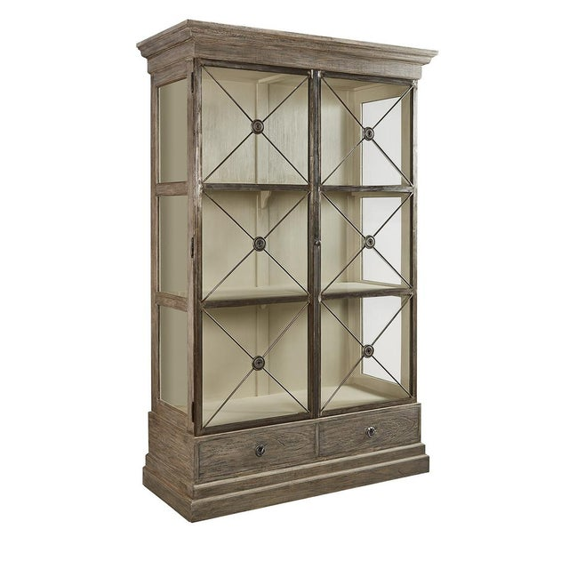 Classic Directoire styling is highlighted in this striking cabinet. Featuring glass doors with distinctive metal accents,...