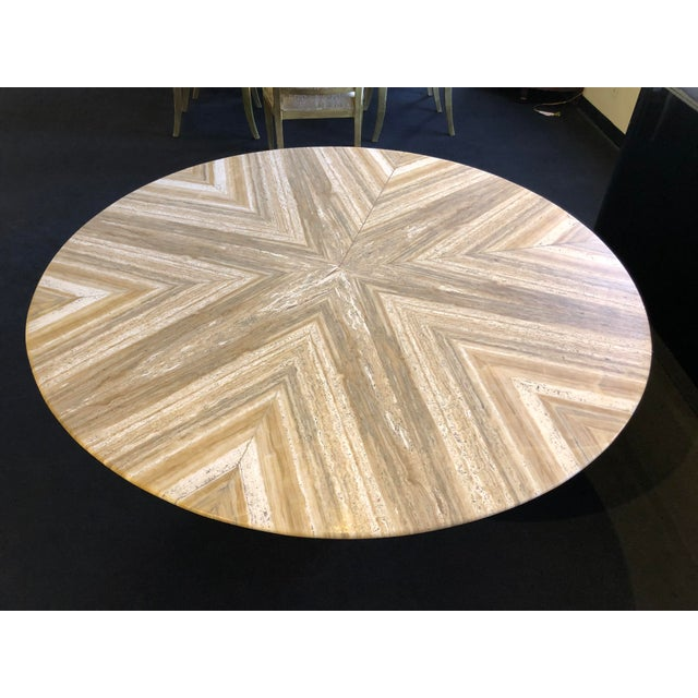 Imported from Italy. Walnut Travertine stone table match-booked pattern with pedestal base.