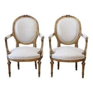 19th Century Carved Giltwood French Louis XVI Style Open Armchairs For Sale