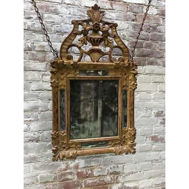Louis XIV, carved gilt wood mirror, Provenance , France This Louis XIV mirror is exuberant, symmetrical and nicely...