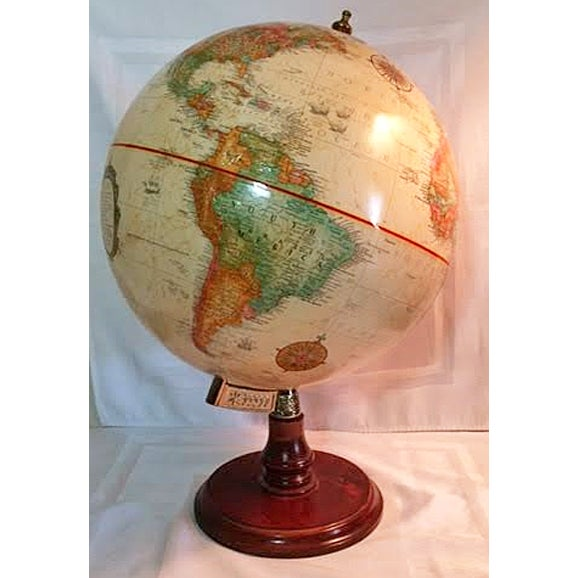 "This is a 12"" Replogle World Classic Series globe. Pristine condition. The base is walnut with a burnished brass-plated..."