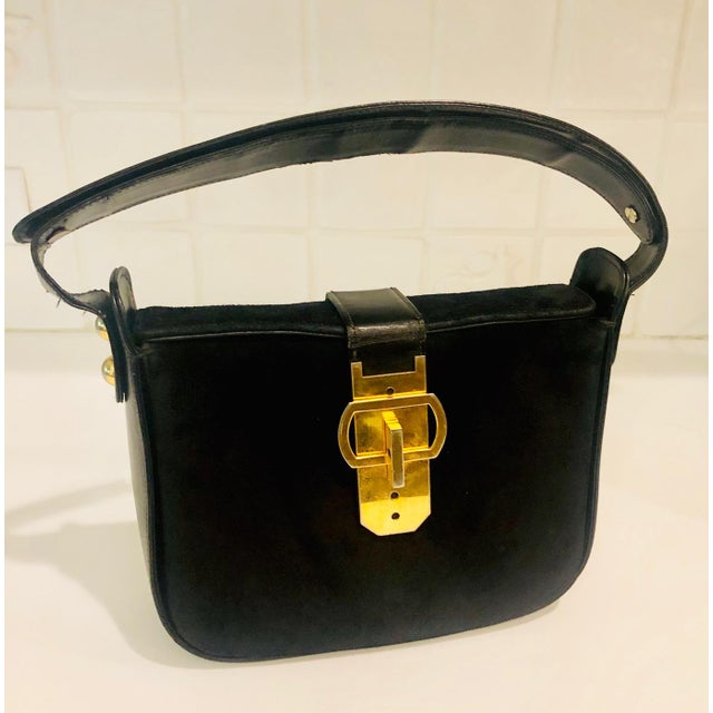 Fantastic craftsmanship in this bold shoulder bag made in France for Saks Fifth Avenue. Soft suede body with double...