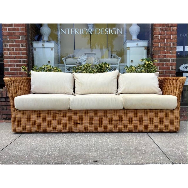 Gorgeous Boho Chic Rattan Tuxedo Sofa with upholstered cushions and back cushions. This Classic Sofa just needs your...