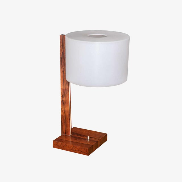 Rosewood 1960's Swedish desk lamp with solid wood base and plastic shade. 1960s. Marked Luxus.