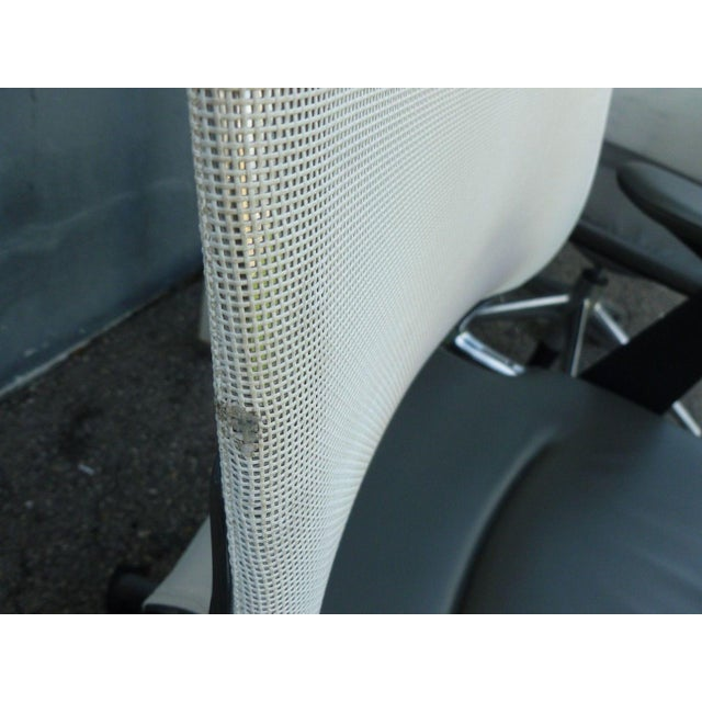 5 Vitra Albert Meda chair with mesh back , leather seat, and armrests sold as found in good condition showing only...