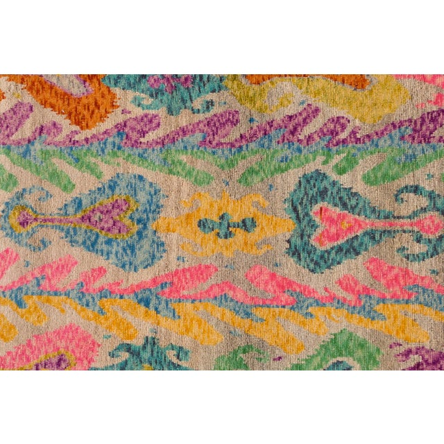 A hand-knotted modern Afghan Gabbeh rug with an allover abstract design. This piece has great detailing and colors. It...