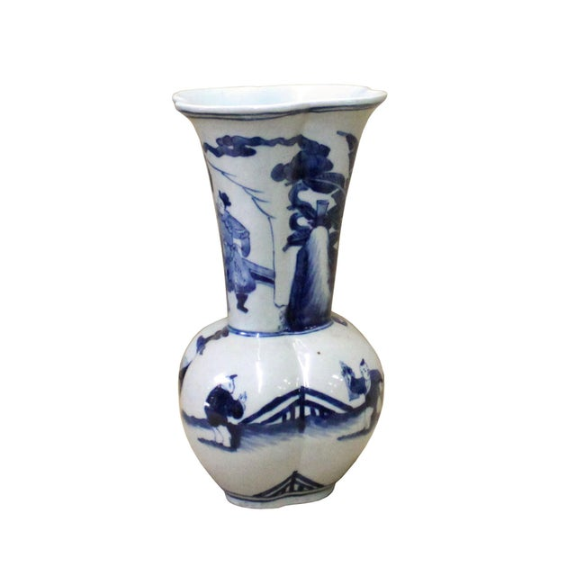 This is a traditional Chinese decoration vase in blue & white color with detail combination of oriental flower and people...