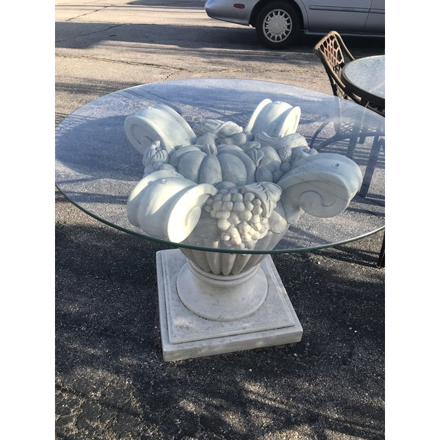 Gorgeous thick fiberglass floral urn shaped white column table with circular glass top. Minor crack in pedestal base but...