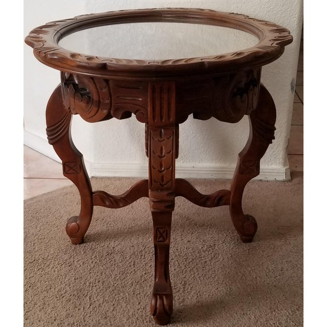 We love this extraordinary nearly antique tea or coffee table for the intricate ornate carving and removable glass tray on...