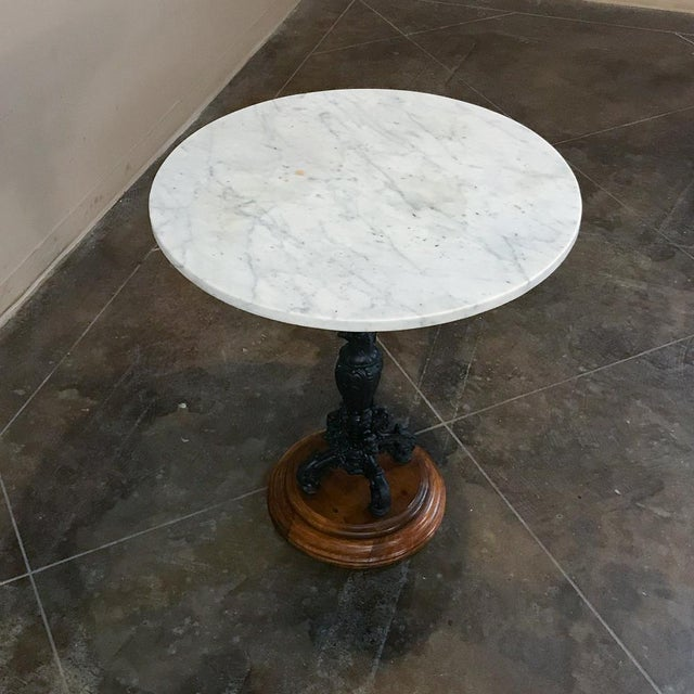 19th Century Cast Iron Marble Top Café Table is a marvel of detail in exceptionally well preserved condition! The...