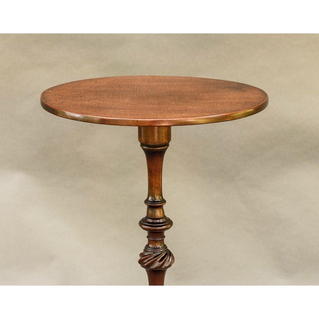 Fine quality French solid mahogany wine table featuring a hand-turned pedestal terminating in pad feet, circa 1910. This...