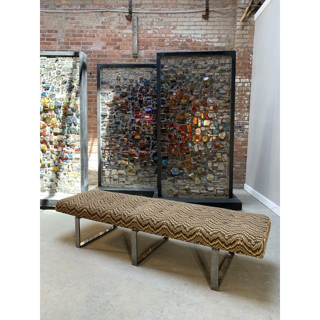 Modernist origins are evident in the sleek architecture of this contemporary smoked chrome and textile covered bench by...