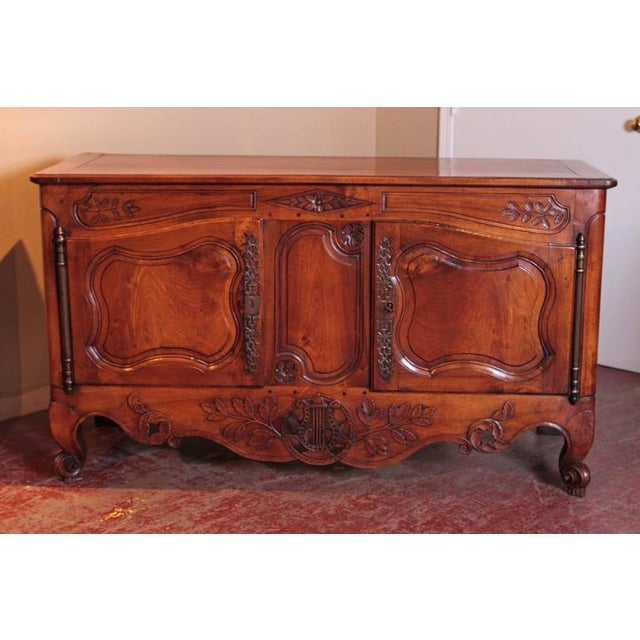 Use this beautifully carved antique buffet for storage in your dining room, living room or bedroom. This Provençal buffet...