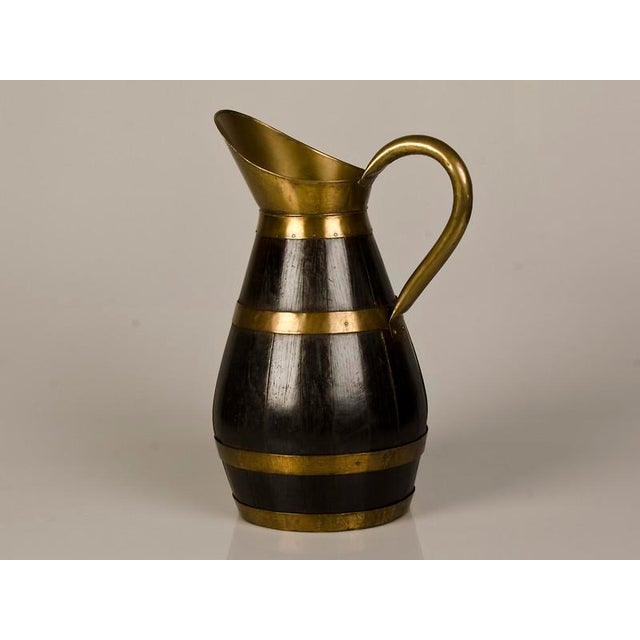 A huge brass banded oak pitcher for pouring beer in a pub from England c.1890. This is a wonderful reminder of a way of...