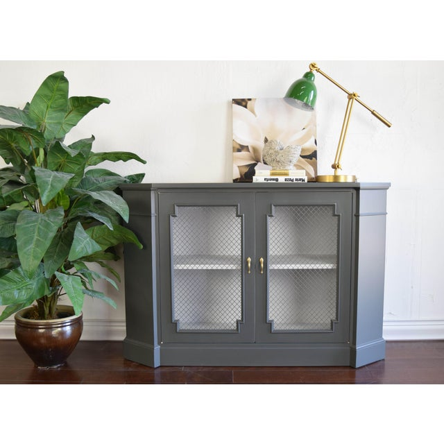 Unique gray cabinet with wire mesh. Painted in a flat custom gray and white in the interior. Original handles were...