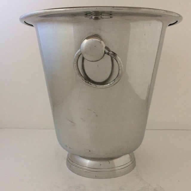 This is a large well made polished aluminum Champagne Bucket that is two pieces. Each piece has been turned on a machine...