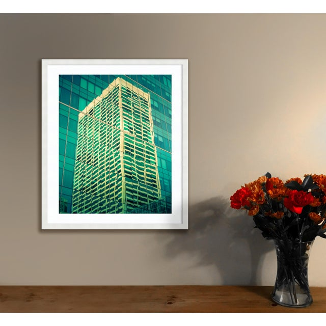 A building reflected into another building - this is the scene I found at Bryant Park in Manhattan. Hughes of green and...