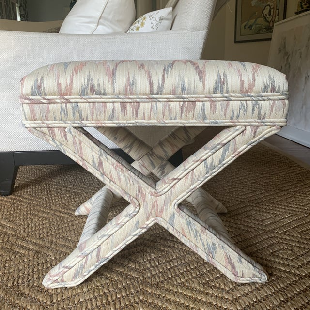 Chic vintage Weiman upholstered x bench in very good condition. Ivory, pale grey and rose zig zag upholstery and double...