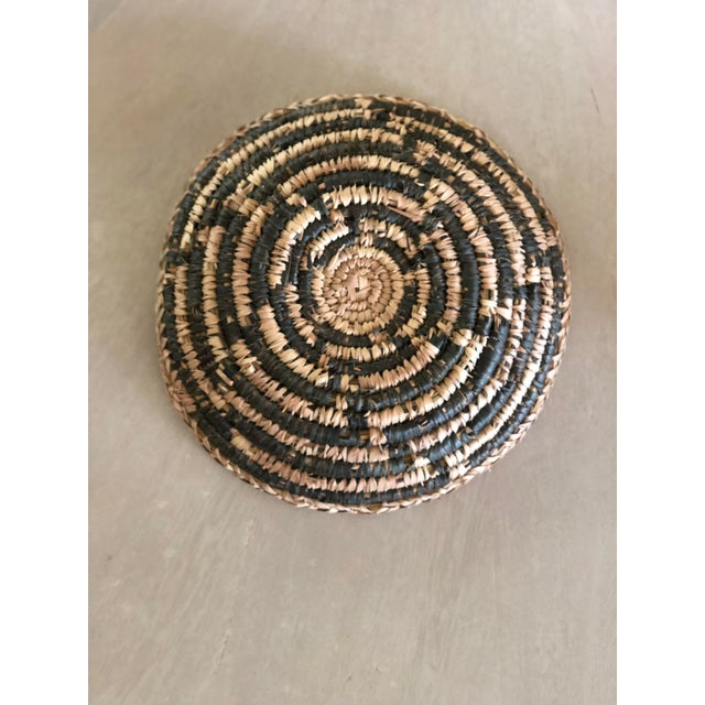 Excellent vintage condition, handmade vegetable dyed African basket, charcoal and natural grass color.