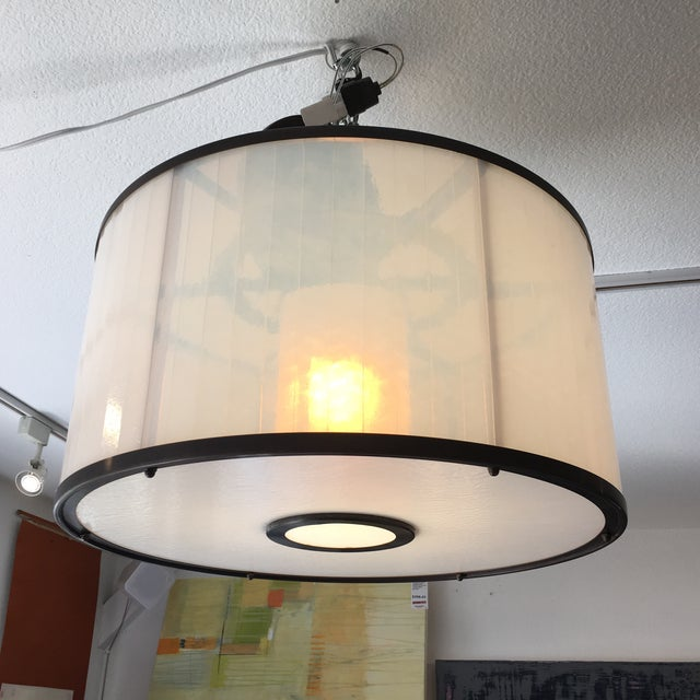 Design Plus Consignment Gallery presents the Michael McEwen B Ring ceiling fixture. This quietly beautiful light has a...