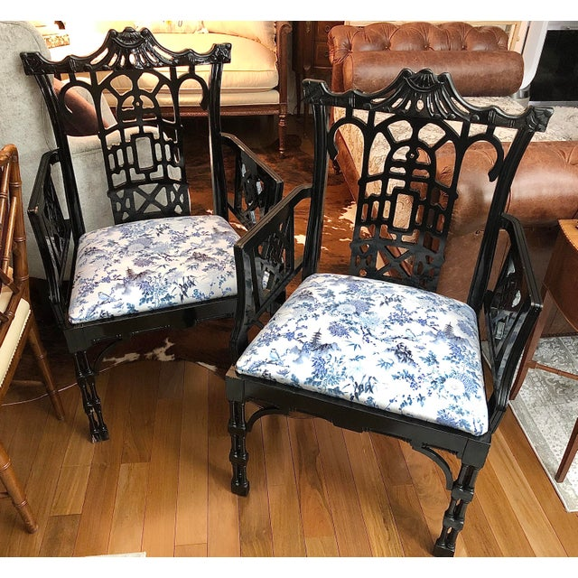 Very hard to find! Set of two Faux bamboo pagoda arm chairs. Original manufacturers finish. Chairs are not original...