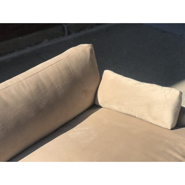 Newly reupholstered mid century in Khaki Velvet. Wood platform holds couch. Streamline design. New reupholstery includes...
