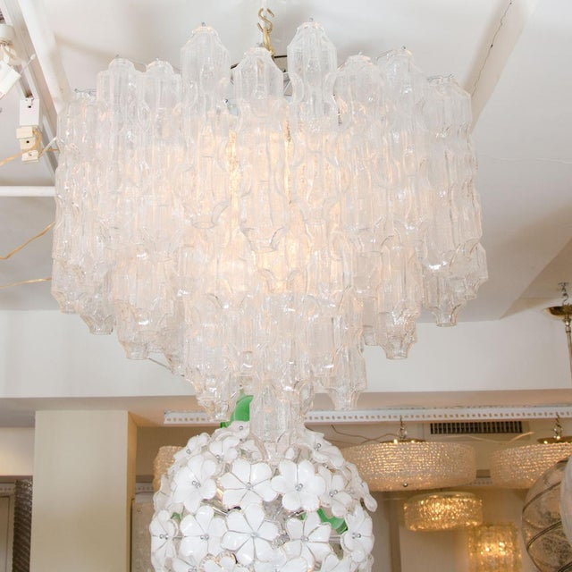 "Multitiered chandelier composed of textured glass elements. Origin: Austria Circa: 1960 Dimensions: 27"" diameter x 22""..."