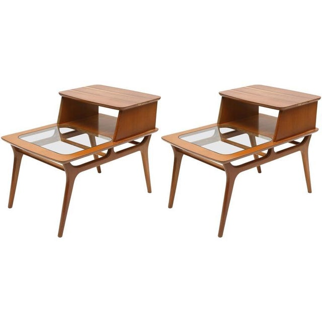 Pair of vintage Heywood-Wakefield two-tiered side tables, 1960s, USA. Tops have been veneered at some point in history.