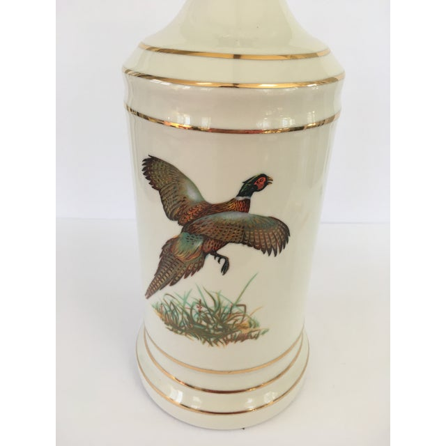 Vintage pheasant lamp with gold accents. Comes with the original harp and finial. Takes a standard bulb.