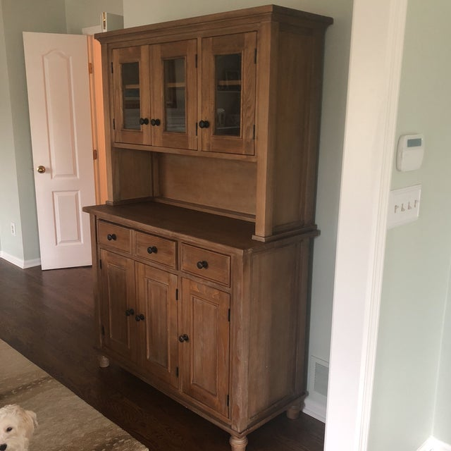 Crate and Barrel Hutch, two pieces that attach, comes with wall anchors. A contemporary classic!