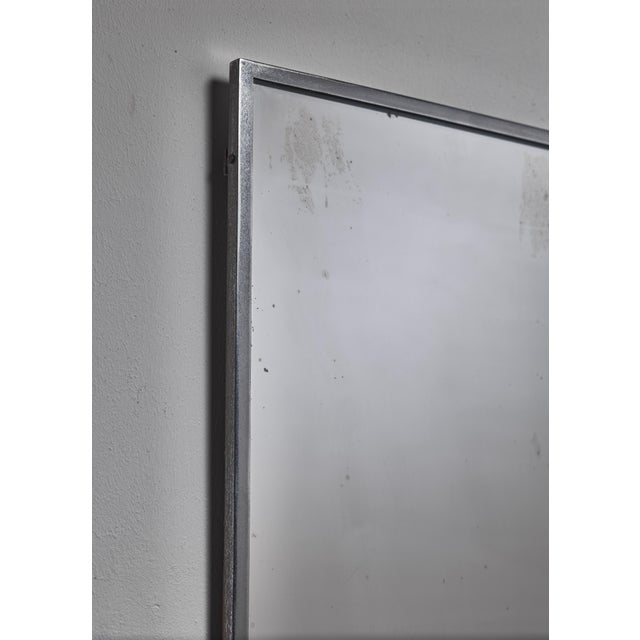 A simple and elegant 1950s rectangular Italian wall mirror with a thin nickel frame. The natural wear gives this otherwise...