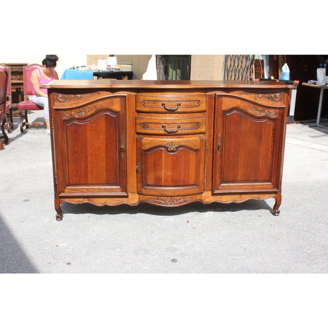 Beautiful country French Louis XV period sideboard handcrafted of solid oak and beautifully patinated ,by talented...